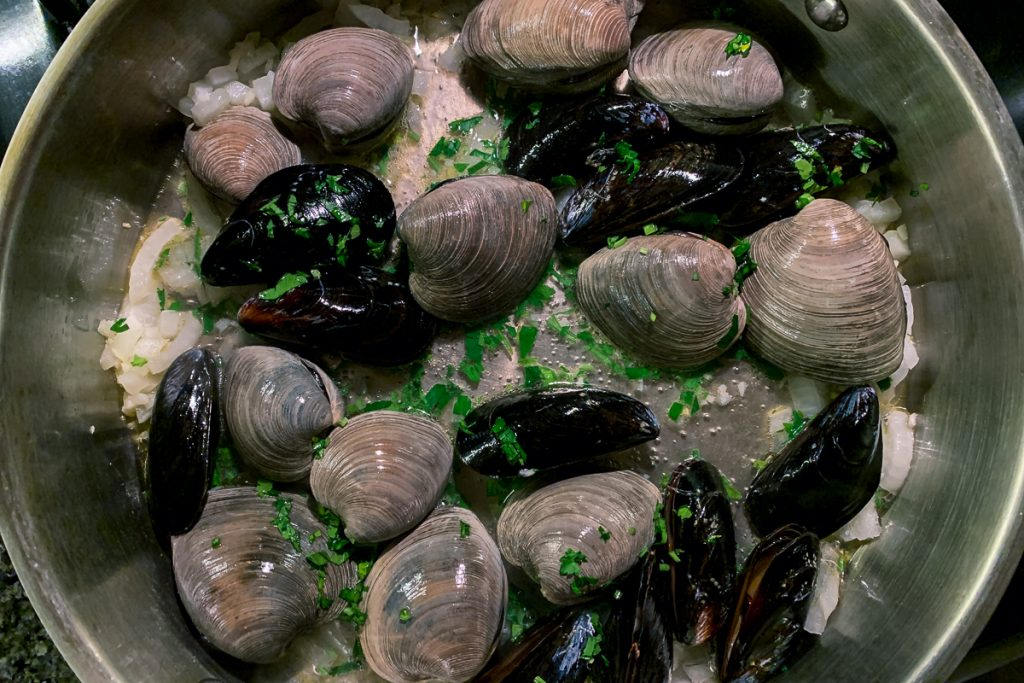 Mussels and Clams Cooking with Parsley